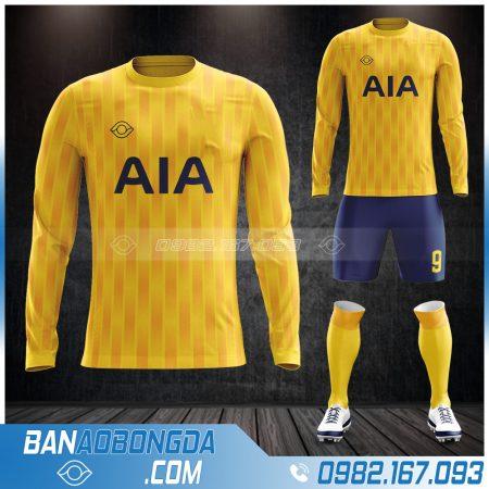 Áo đá bóng k logo dt màu vàng